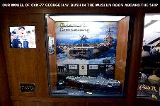 Our model of the CVN-77 George H.W. Bush in the ships museum room